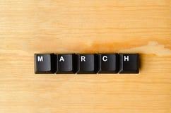 Palavra de março fotografia de stock
