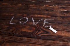 Palavra do amor escrita com giz Fotos de Stock Royalty Free
