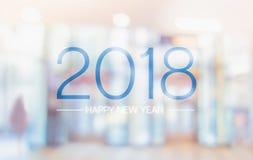 Palavra do ano novo feliz 2018 no offi pálido do salão de convenção da cor do borrão foto de stock royalty free