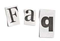 A palavra do FAQ fêz letras do jornal do ââof Imagem de Stock Royalty Free