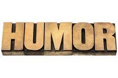 Palavra do humor no tipo de madeira imagem de stock royalty free