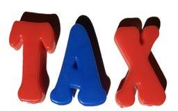 Palavra do IMPOSTO com alfabetos do brinquedo imagens de stock