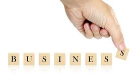 Palavra do negócio da mão e da palavra Imagens de Stock