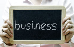 Palavra do negócio escrita no quadro-negro/chalckboard Foto de Stock