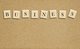 Palavra do negócio na placa da cortiça Foto de Stock
