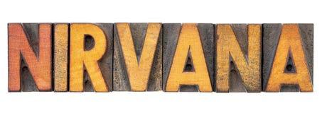 Palavra do nirvana no tipo da madeira da tipografia fotos de stock royalty free
