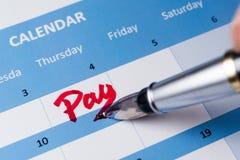 Palavra do pagamento no calendário fotografia de stock