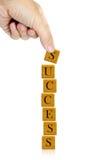 Palavra do sucesso da mão e da palavra Fotografia de Stock Royalty Free