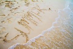 Palavra do VERÃO escrita na areia Fotografia de Stock