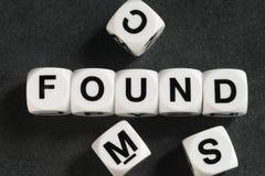 Palavra encontrada em cubos do brinquedo Fotografia de Stock Royalty Free