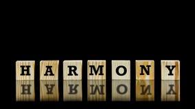 A palavra - harmonia - em cubos de madeira Fotografia de Stock