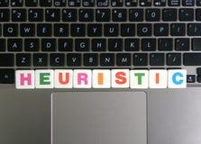 Palavra heurística no fundo do teclado Imagem de Stock Royalty Free