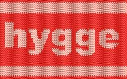 Palavra HYGGE na textura de confecção de malhas Foto de Stock