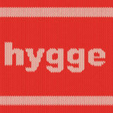 Palavra HYGGE na textura de confecção de malhas Imagens de Stock Royalty Free