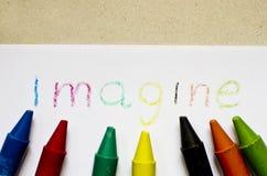 A palavra IMAGINE escrita no papel fotografia de stock