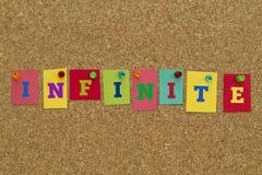 Palavra infinita escrita em notas pegajosas coloridas Imagens de Stock
