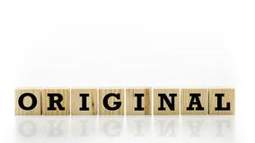 A palavra - original - em blocos de madeira Fotografia de Stock Royalty Free