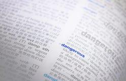 Palavra perigosa no ¼ Œmeaning do dictionaryï fotos de stock