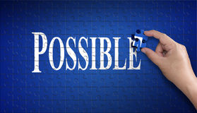 Palavra possível no enigma de serra de vaivém Mão do homem que guarda um enigma azul t Imagem de Stock