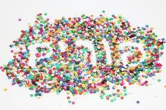 A palavra Purim no hebraico feito dos confetes Fotografia de Stock Royalty Free