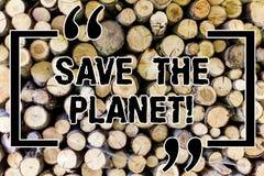 Palavra que escreve o texto salvo o planeta Conceito do negócio para o cuidado da tomada do ambiente para fazer as ações ecológic imagem de stock royalty free