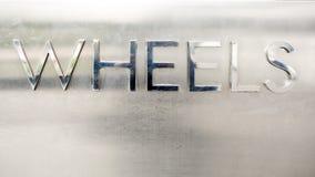 A palavra roda com materiall do metal - ilustração 3d Fotos de Stock Royalty Free
