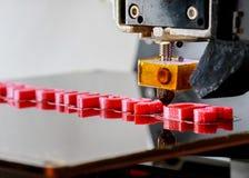 palavras da impressão da impressora 3D com plástico vermelho Imagem de Stock