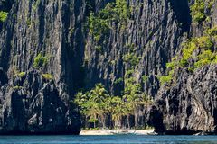 Palawan beach and limestone cliffs Royalty Free Stock Photo