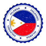 Palawan flag badge. Vintage travel stamp with circular text, stars and island flag inside it. Vector illustration Royalty Free Stock Images