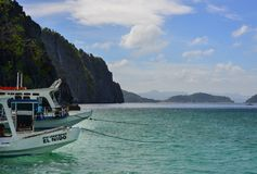 Landscape of tropical sea at sunny day. Palawan, Philippines - Apr 5, 2017. Tourist boats on the sea at jetty in Palawan, Philippines. Palawan is one of the most stock photo