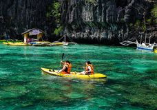 Landscape of tropical sea at sunny day. Palawan, Philippines - Apr 5, 2017. Tourists rowing kayaks at blue lagoon in Palawan, Philippines. Palawan is one of the royalty free stock photo