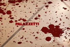 Palazzetti logo on the floor with red color stains from Giulio Masieri Audiopaint performance Stock Photography