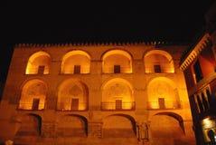Palazzo antico illuminato vicino al Guadalquivir Fotografia Stock
