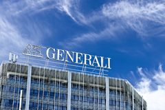 Palazzo with Assicurazioni Generali sign in Milan.  The blue sky is the background of the Italian insurance company royalty free stock photography