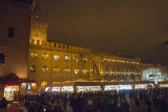 Palazzo d`Accursio and chocolate market at Piazza Maggiore by night. Bologna. Emilia-Romagna region. Italy. Stock Photos