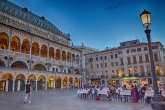 Palazzo della Ragione,  Padua, Italy. Dinner at the cafe at sunset Royalty Free Stock Photos