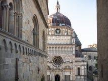 Palazzo della Ragione and view of Colleoni Chapel. Travel to Italy - wall of Palazzo della Ragione and view of Colleoni Chapel on Piazza Duomo in Citta Alta ( royalty free stock photography