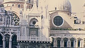 Palazzo Ducale internal Court. Internal courtyard of Palazzo Ducale, Venice, Veneto, Italy on circa June 1967, San Marco Basilica facade and detail of external stock footage