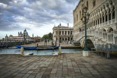 The doge`s palace on the st marks square in venice on a dark clo. The Palazzo Ducale on the piazza San Marco in venice on a dark cloudy day Royalty Free Stock Image