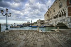 The doge`s palace on the st marks square in venice on a dark clo. The Palazzo Ducale on the piazza San Marco in venice on a dark cloudy day Royalty Free Stock Images
