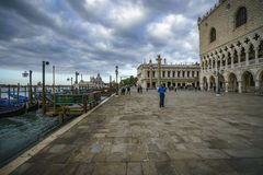 The doge`s palace on the st marks square in venice on a dark clo. The Palazzo Ducale on the piazza San Marco in venice on a dark cloudy day Stock Images