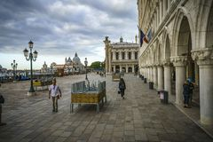 The doge`s palace on the st marks square in venice on a dark clo. The Palazzo Ducale on the piazza San Marco in venice on a dark cloudy day Stock Photos