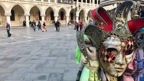 Palazzo e maschere del ` s del doge al quadrato di San Marco, Venezia, Italia Fotografia Stock