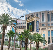 The Palazzo Hotel and Casino sign. Behind palm trees Royalty Free Stock Images