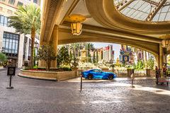 Palazzo Hotel and Casino valet parking. Blue Ferrari in the Velvet parking area for The Palazzo Hotel and Casino Stock Photo
