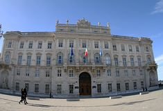 Palazzo Lloyd Triestino 2019. Building.Italy. Three flags are on the building stock photos