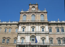 Palazzo in Modena. Old palace in Modena in front of blue sky background Stock Photos
