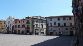 Palazzo Podestà with clock tower at Plebiscito square in Viterb stock video
