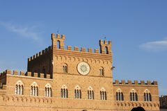 Palazzo Publico in Piazz del Campo, Siena, Italy. Palazzo Publico (Town hall) of Siena, Tuscany, Italy and is bell tower (Torre del Mangia) dominate the Stock Photos