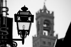 Palazzo Vecchio and light. Soft focus of the Palazzo Vecchio Tower and streetlight lamp, Florence Italy royalty free stock images